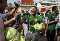Irish supporters hold green cabbages as they cheer before the Euro 2012 soccer match between Italy and Ireland in Poznan