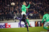 Anderlecht's Emmanuel Sowah and Saint-Etienne's Alexander Soderlund fight for the ball during the sixth and last game in the group stage (group C) of the UEFA Europa League competition between Belgian soccer club RSC Anderlecht and French club AS Saint-Et